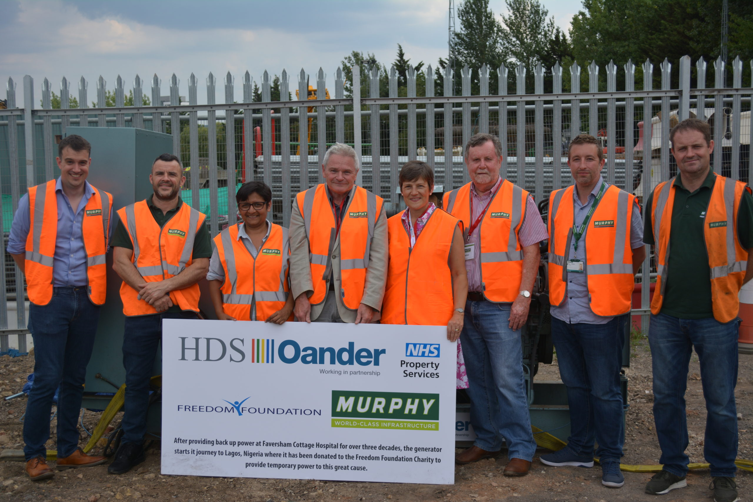 Staff from J Murphy and Oander in front of the former backup generator