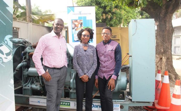 Delegates from the Freedom Foundation in front of the generator