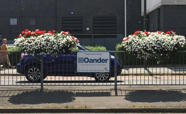 Crawley flower boxes on the roadside sponsored by Oander
